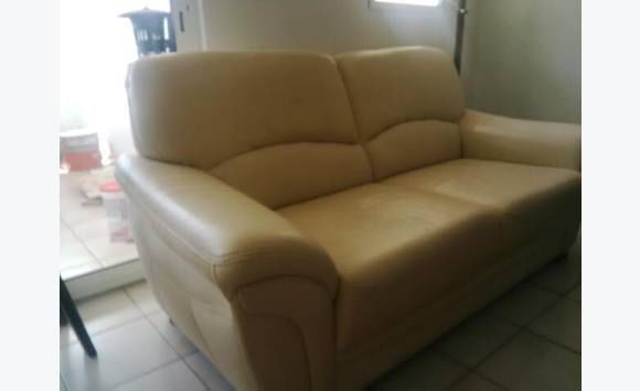 Two Used Beige Leather Sofas